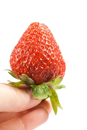 Strawberry in womans hand isolated on white  photo