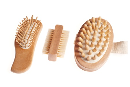 repertoire: Bath anti-cellulitis spa massage kit with comb, brush and hairbrush isolated on white background.