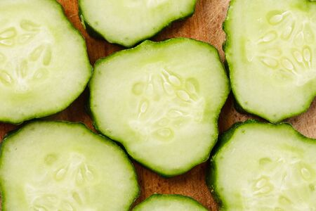 Sliced cucumber on the wooden hardboard