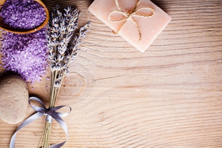 Lavender treatment soap, sea salt and stone on wooden table with copy space Stock Photo - 10338945