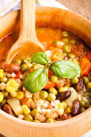 Minestrone soup in wooden bowl closeup. Traditional italian dish Stock Photo - 10338939