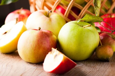 Fresh various apples closeup on wooden table Stock Photo - 10366801