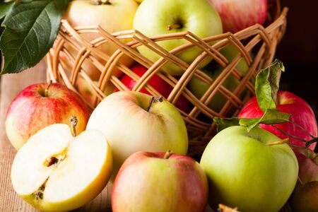 Fresh various apples closeup on wooden table Stock Photo - 10366802