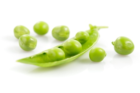 Fresh pea pods with flower isolated on white photo