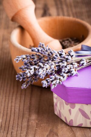 Lavender bunch on the wooden table closeup and mortar photo
