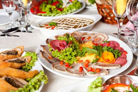 Various meat slices on white plate - collation photo