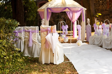 the place is outdoor: Outdoor wedding ceremonys place prepared for guests
