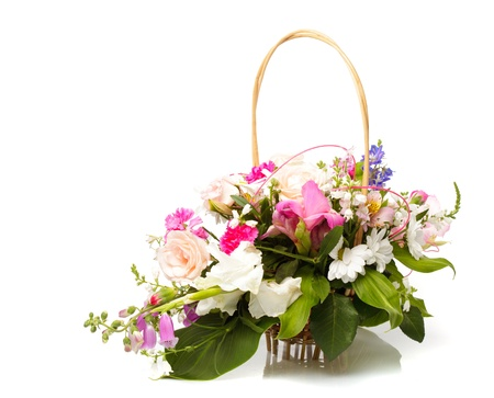 ikebana: Bouquet from different pink seasonal flowers of september in basket isolated on white