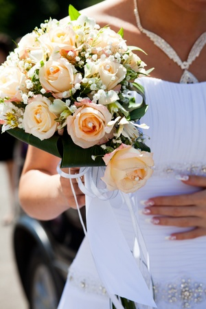 buttonhole: Wedding bouquet from peach-coloured roses and buds Stock Photo