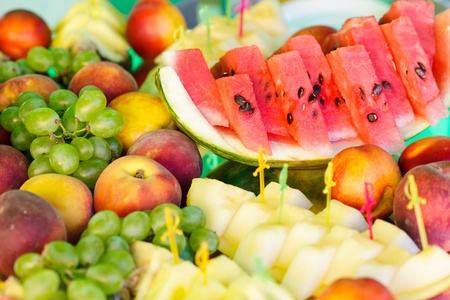 Various slices of fruits on the mirror stand prepared for eating Stock Photo - 10595190