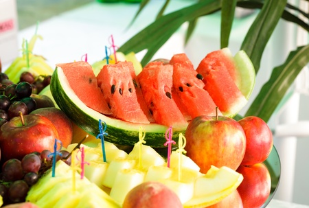 Various slices of fruits on the mirror stand prepared for eating photo