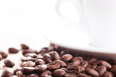 Coffee beans and white cup with copy-space photo