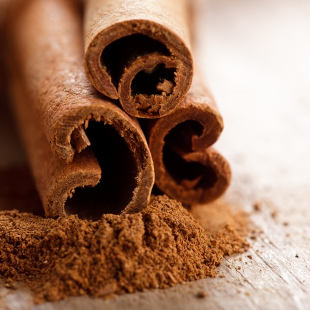 Cinnamon sticks and meal close up on wooden table Stock Photo - 10823536