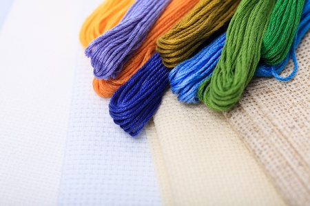 Different color hreads and canvas for cross-stitch photo