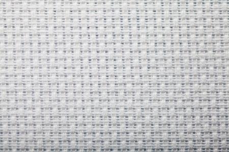 cross-stitch canvas texture closeup. Copy space photo