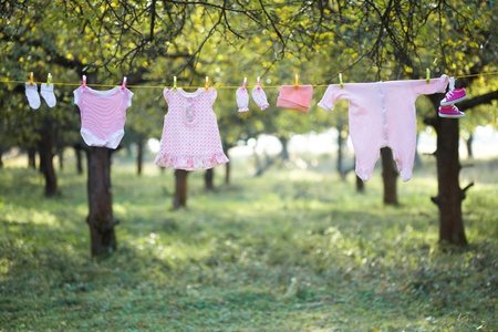 Pink baby wear outdoor in garden photo