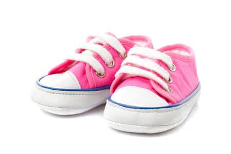 pink shoes: Pink baby footwear - gymshoes isolated on white Stock Photo