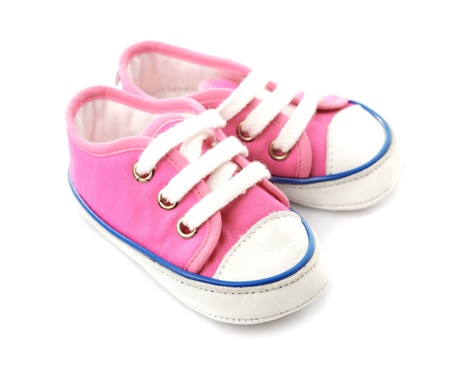 Pink baby footwear - gymshoes isolated on white photo