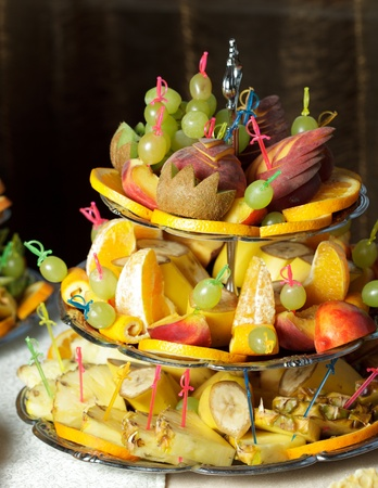 Various slices of fruits on the silver stand prepared for eating Stock Photo - 10893465