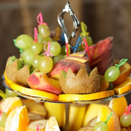 Vaus slices of fruits on the silver stand prepared for eating Stock Photo - 10893464