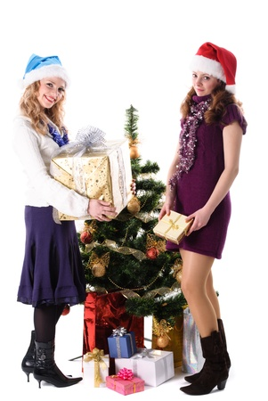 Christmas santa girl with gift give a present isolated on white photo