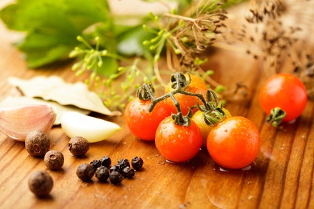 Still life of preserving tomatoes on wooden table in kitchen