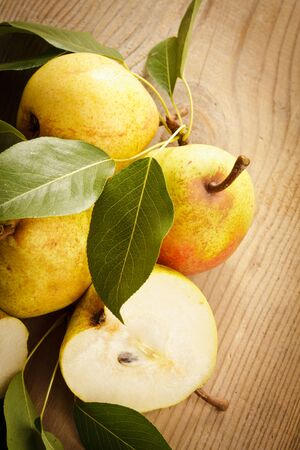 Ripe pears closeup on wooden table photo