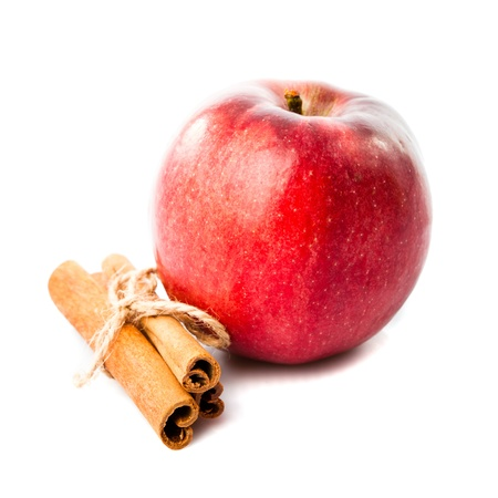 Good combination of apple and cinnamon isolated on white photo