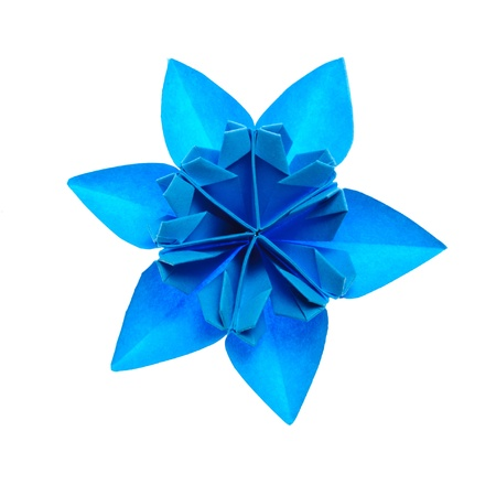 blue origami unit snowflake isolated on white background photo