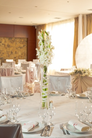 White beautiful table set for a wedding dinner