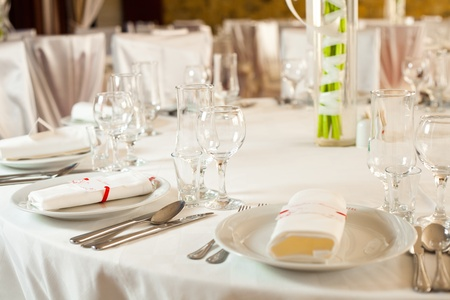 White beautiful table set for a wedding dinner Stock Photo - 11465652