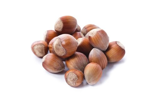 avellan: Ripe hazelnuts isolated on white Stock Photo