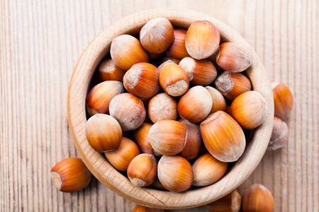 avellan: Ripe hazelnuts on the wooden table