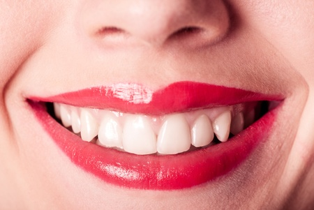 Red lips smile closeup with white teeth photo