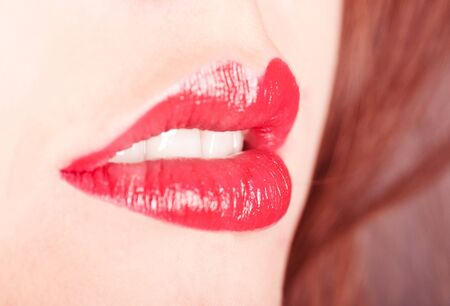 Red lips smile closeup, shallow DOF, focus on theeth Stock Photo - 11467287