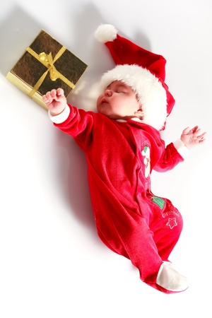Cute baby in santa wear on white photo