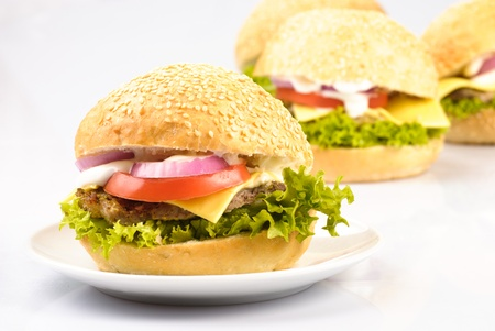 four homemade hamburgers isolated on white background photo