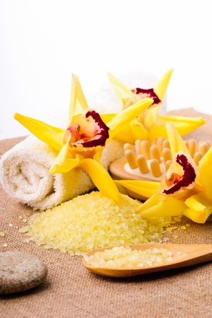 yellow bathing salt in the wooden spoon, spa concept Stock Photo - 11912431