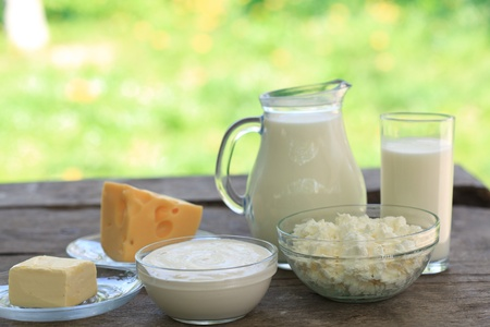 Dairy products on wooden table, selective focus, shallow deep of field photo