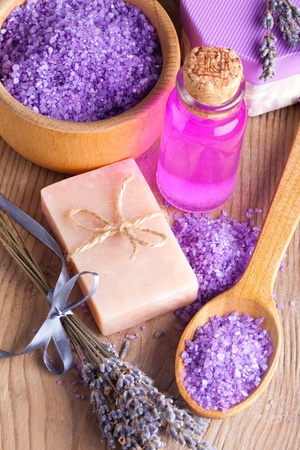 Lavender treatment soap and sea salt on wooden table photo