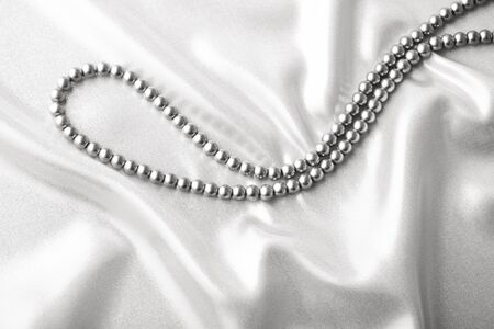 Background from beads on silk textile photo