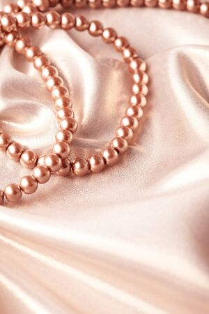 Background from beads on silk textile Stock Photo - 12030996