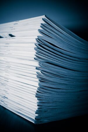 Stack of white journals on table, closeup blue toned Stock Photo - 12030950