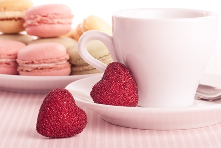 include: Dessert on valentines include macaroons, coffee and red hearts Stock Photo