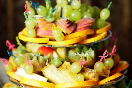 Various slices of fruits on the silver stand prepared for eating Stock Photo - 12320564