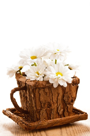 White daidies in wooden cup, postcard Stock Photo - 12320700