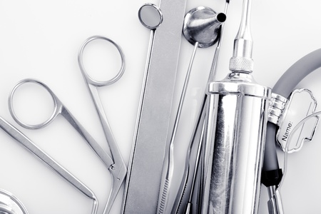 Medical instruments for ENT doctor on white photo