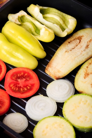 Vegetables prepared to cook on grill pan photo