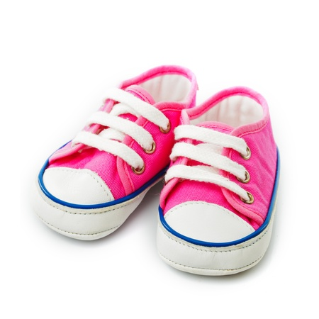 baby shoes: Pink baby footwear - gymshoes isolated on white Stock Photo