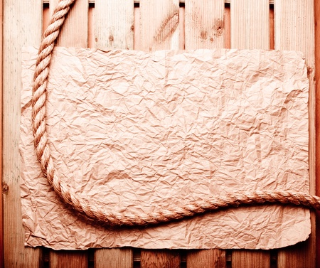 Old crumpled paper and rope photo
